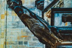 Czech architecture, scary gargoyle sculpture, gothic temple decoration. Medieval art, mystic gargoyle monster statue, St. Vitus C stock photo
