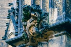 Czech architecture, scary gargoyle sculpture, gothic temple decoration. Medieval art, mystic gargoyle monster statue, St. Vitus C royalty free stock photography