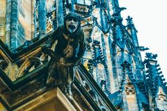Czech architecture, scary gargoyle sculpture, gothic temple decoration. Medieval art, mystic gargoyle monster statue, St. Vitus C stock photography