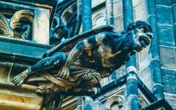 Czech architecture, scary gargoyle sculpture, gothic temple decoration. Medieval art, mystic gargoyle monster statue, St. Vitus C stock images
