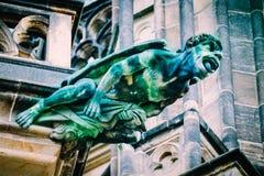 Czech architecture, scary gargoyle sculpture, gothic temple decoration. Medieval art, mystic gargoyle monster statue, St. Vitus C stock image