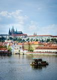 Prague - river, boat and castle Stock Photography