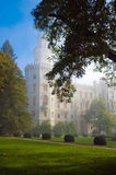Czech castle Hluboka nad Vltavou in myst. Ic fog. View from park side Stock Photography