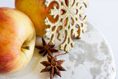 Czech christmas - golden snowflake, apples and star anise Royalty Free Stock Images