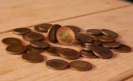Czech coins on wooden table. Czech coins with a value of 50 crowns on wooden table stock images