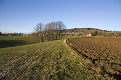 Czech countryside. Plowed fields and green meadow in the autumn afternoon Royalty Free Stock Photography