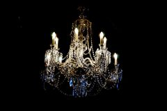 Czech crystal chandelier. In the dark night royalty free stock image