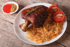 Czech cuisine: Baked shank and sauerkraut closeup. horizontal Royalty Free Stock Photography