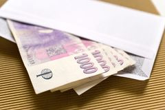 Czech economy and finance - czech crown banknotes in a envelope - bribe and corruption. Concept stock photography