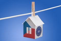 Czech and EU flag on paper house. Concept - Czech and EU flag painted on a paper house hanging on a rope Stock Photos