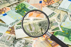 Czech and euro money background with magnifying glass Stock Image