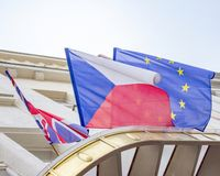 Czech and European flags blowing in the wind. The English, Czech and European flags blowing in the wind brexit royalty free stock images