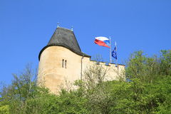 Czech and European flags. Blowing in the wind by the old roof of castle Karlstejn (Czech Republic stock photos