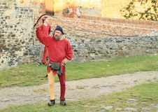 Czech famous juggler Zdenek Vlcek with scourge. Czech famous juggler Zdenek Vlcek juggling with scourge at 'Conquest of water castle Svihov' (Czech Republic, the Stock Images