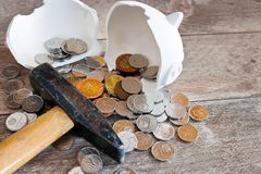 Czech finance and economy - Piggy bank with hammer and money / Royalty Free Stock Photography