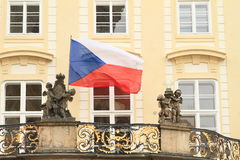 Czech flag. On balcony with decorated railings with statues on Prague Castle (Czech Republic royalty free stock photos