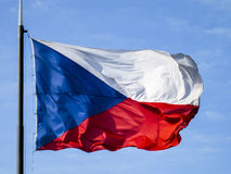 Czech Republic Flag blowing in the wind, blue sky background Royalty Free Stock Image