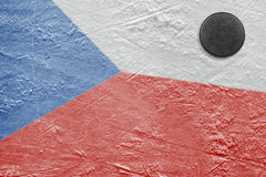 Czech flag and puck on the ice Royalty Free Stock Photo