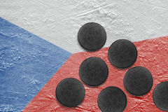 Czech flag and puck on the ice Stock Image