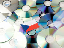 Czech flag on top of CD and DVD pile isolated on white. Czech flag on top of CD and DVD pile isolated Royalty Free Stock Photos