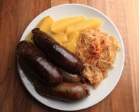 Czech food - black and white pudding and sauerkrau Royalty Free Stock Images