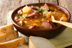 Czech food: Zelnacka cabbage soup with sausages and vegetables c royalty free stock image
