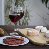 Czech Hermelin cheese and wine. Glasses Royalty Free Stock Photography
