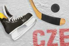 Czech hockey stick, skates and the puck on the ice Stock Photo