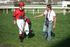 Czech horse-racing legend Josef Vana. Famous czech horse-racing jockey and trainer Josef Vana with his ward - jockey Tomas Lukasek after finishing TOTO CZ Prize Royalty Free Stock Image