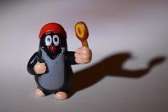 Czech small mole with lollipop. Czech little mole with lollipop royalty free stock photography