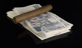 Czech money. With cigar on black background royalty free stock photo