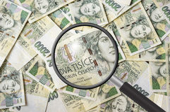 Czech money background with magnifying glass Stock Photography