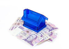 Czech money banknotes and moneybox. Czech money banknotes nominal value one thousand and moneybox on white background Royalty Free Stock Photo