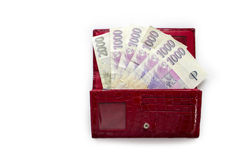Czech money CZK in red wallet. Czech money on the positive side in red wallet on the white background Royalty Free Stock Photography