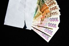 Czech money in an envelope. On a black background Royalty Free Stock Image