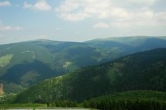 Czech mountain. With forest, blue sky and white cloud stock photo