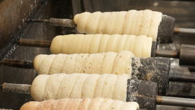 The Czech national dish Trdelnik is cooked and roasted. The Czech national dish Trdelnik or Trdlo is cooked and roasted stock footage