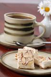 Czech nougat and coffee. A confectionary similar to the hard variety of the Spanish turron and Italian torrone produced in the Czech Republic. It is called Royalty Free Stock Images