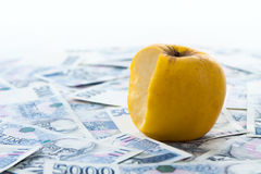 Czech paper money with apple Royalty Free Stock Photography