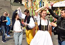 Czech people in traditional costume dancing. With Tourists in Old Town Square Prague, during the Easter time Stock Image