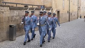 Czech Presidential Guard Marching in Prague Castle. Prague, Czech Republic - August 17 2019: Czech Presidential Palace Guard Marching in Light Blue Uniforms with stock footage