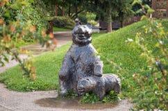 Czech Republic. Bear sculpture and a small teddy bear in the Prague zoo. June 12, 2016. Czech Republic. Prague. Bear sculpture and a small teddy bear in the stock image
