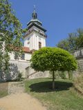 Old town hall tower in castle park Benatky nad Jizerou with footpath, stair, green trees, sunny summer day, blue sky background. Czech Republic, Benatky nad Royalty Free Stock Photo