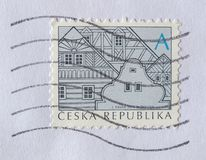 Czech stamp with Czech traditional architecture Stock Photo