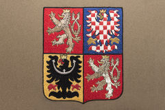 Czech Republic coat of arms. Embroidery of Czech Republic coat of arms on gray fabric Royalty Free Stock Photo