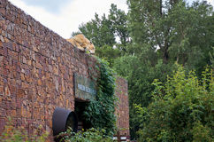 Czech Republic. The figure of a tiger looking to the height of the house roof in the Prague zoo. June 12, 2016. Czech Republic. Prague. The figure of a tiger Stock Images