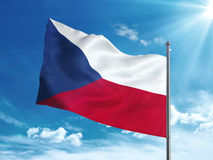 Czech Republic flag waving in the blue sky. Czech flag waving in the blue sky Royalty Free Stock Images