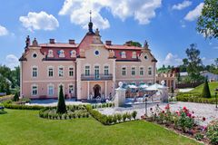 Castle Berchtold from 1877 and park with model miniatures of czech landmarks, Benice, Vidovice village, Czech republic. CZECH REPUBLIC, KUNICE - JUN 15, 2015 Royalty Free Stock Image