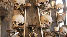Czech Republic. Kutna Hora. Skulls and bones in the ossuary in Kutna Hora.  stock footage