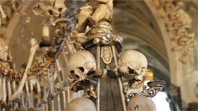 Czech Republic. Kutna Hora. Skulls and bones in the ossuary in Kutna Hora.  stock video